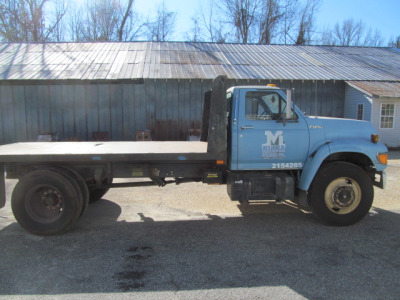 Ford with flatbed dump