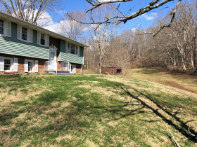12.7 Acres and Split Foyer Home featured photo 5