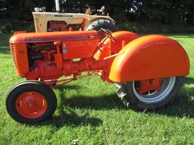 6. 1947 Case Mod. VAO, WF, orchard fenders, NEW pa