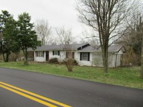 House, Mobile Home & Lots on Fall Lick Rd. - Absolute Online Only Auction featured photo 1