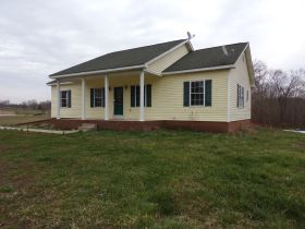 Online Bidding Only - 4 BR HOME W/ BSMT, GAR., POND & 2 AC-Bidding Ends Friday, July 17th @ 4 PM EDT featured photo 1