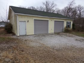 Online Bidding Only - 4 BR HOME W/ BSMT, GAR., POND & 2 AC-Bidding Ends Friday, July 17th @ 4 PM EDT featured photo 4
