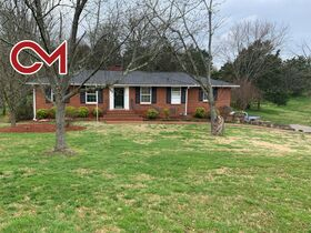LISTING: Unique 4 BR, 3 BA Brick Home, Basement with Sep. Living Quarters on 1.46+/- Acres - 623 Ronnie Rd, Madison, TN featured photo 1