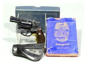 police man's gun, holster and report book