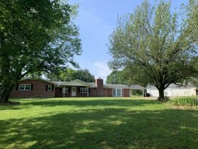 AUCTION featuring 3 BR, 3.5 BA Brick Home + Outbuildings on 30+/- Acres - Offered in Tracts featured photo 4