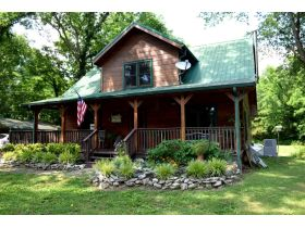 AUCTION: 3 BR, 2.5 BA Log Home on 85+/- Acres with Large Pastures - Hardwood Trees - 2 Extra Soil Sites - 2 Barns - Storage Shed - Pool and More! featured photo 2