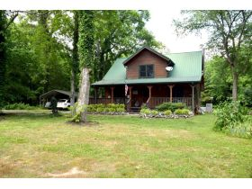 AUCTION: 3 BR, 2.5 BA Log Home on 85+/- Acres with Large Pastures - Hardwood Trees - 2 Extra Soil Sites - 2 Barns - Storage Shed - Pool and More! featured photo 4