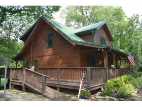 AUCTION: 3 BR, 2.5 BA Log Home on 85+/- Acres with Large Pastures - Hardwood Trees - 2 Extra Soil Sites - 2 Barns - Storage Shed - Pool and More! featured photo 5