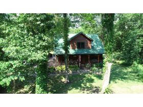 AUCTION: 3 BR, 2.5 BA Log Home on 85+/- Acres with Large Pastures - Hardwood Trees - 2 Extra Soil Sites - 2 Barns - Storage Shed - Pool and More! featured photo 6