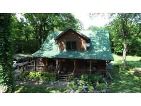 AUCTION: 3 BR, 2.5 BA Log Home on 85+/- Acres with Large Pastures - Hardwood Trees - 2 Extra Soil Sites - 2 Barns - Storage Shed - Pool and More! featured photo 7