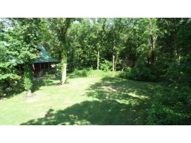 AUCTION: 3 BR, 2.5 BA Log Home on 85+/- Acres with Large Pastures - Hardwood Trees - 2 Extra Soil Sites - 2 Barns - Storage Shed - Pool and More! featured photo 8