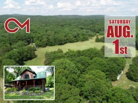 AUCTION: 3 BR, 2.5 BA Log Home on 85+/- Acres with Large Pastures - Hardwood Trees - 2 Extra Soil Sites - 2 Barns - Storage Shed - Pool and More! featured photo 1