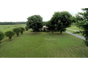 ESTATE AUCTION featuring 3 BR, 2 BA Home on 5+/- Acres with Pond featured photo 4