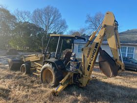 Bankruptcy Auction of a Ford 555 Backhoe featured photo 2