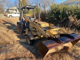 Bankruptcy Auction of a Ford 555 Backhoe featured photo 5