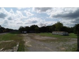 AUCTION: 7.03+/- Acres with Multi-Zoning features 3,857+/- Sq. Ft. Building on 3.43+/- Acres Zoned Commercial General and 3.60+/- Acres Zoned Residential featured photo 9