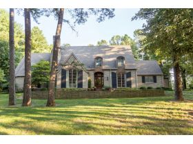 BEAUTIFUL HOME  AND WOODED LOT WITH A TENNIS COURT IN THE GATED COVINGTON GROVE SUBDIVISION featured photo 1