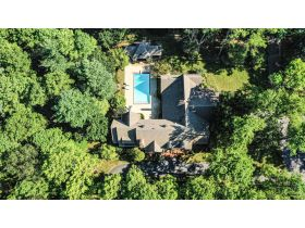 BEAUTIFUL HOME  AND WOODED LOT WITH A TENNIS COURT IN THE GATED COVINGTON GROVE SUBDIVISION featured photo 2
