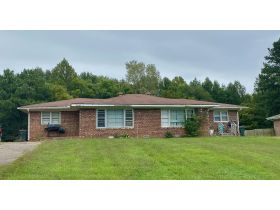 ABSOLUTE ONLINE AUCTION**MONEY MAKING DUPLEX ON K. STREET IN MARTIN TN**GREAT INVESTMENT PROPERTY featured photo 2