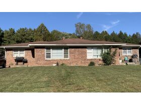 ABSOLUTE ONLINE AUCTION**MONEY MAKING DUPLEX ON K. STREET IN MARTIN TN**GREAT INVESTMENT PROPERTY featured photo 1