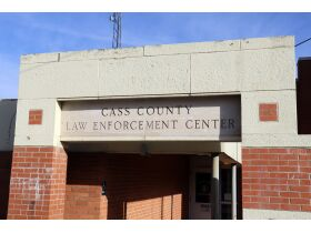 old Cass County jail building front entrance sign