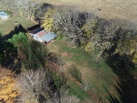 AUCTION featuring 3 BR, 2 BA Log Home on 4.5+/- Acres with Open Floorplan, Large Rec Room, Expansive Deck and Barn featured photo 4