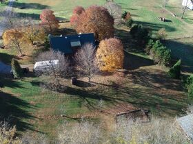 AUCTION featuring 3 BR, 2 BA Log Home on 4.5+/- Acres with Open Floorplan, Large Rec Room, Expansive Deck and Barn featured photo 5