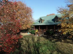 AUCTION featuring 3 BR, 2 BA Log Home on 4.5+/- Acres with Open Floorplan, Large Rec Room, Expansive Deck and Barn featured photo 9