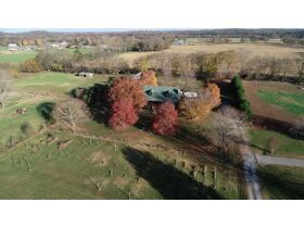 AUCTION featuring 3 BR, 2 BA Log Home on 4.5+/- Acres with Open Floorplan, Large Rec Room, Expansive Deck and Barn featured photo 3
