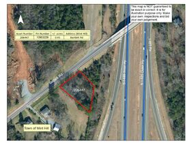 NCDOT 10 Day Upset Period - .45+/- Acres Located at 8038 Bartlett Rd in Charlotte, NC featured photo 1