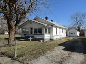 2 BEDROOM HOME - GARAGE - LOTS - Selling in 2 Parcels - Online Bidding Ends THUR, MARCH 4 @ 4:00 PM CST featured photo 1