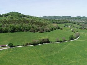 Beautiful 121+/- Acres Offered in Several Tracts - House, Outbuildings, Great Pasture, Scenic Views, Creek & Spring - Estate Auction May 29th featured photo 2