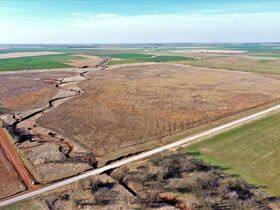 155 ACRES LOCATED SOUTH OF ARGONIA KS   126.2 AC TILLABLE   28.9 AC TAME GRASS   NO GROWING CROP featured photo 2