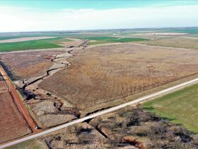 155 ACRES LOCATED SOUTH OF ARGONIA KS   126.2 AC TILLABLE   28.9 AC TAME GRASS   NO GROWING CROP featured photo 4
