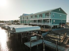 New Construction | Canal Front Townhouse w/ Slip featured photo 4