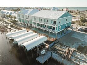 New Construction | Canal Front Townhouse w/ Slip featured photo 1
