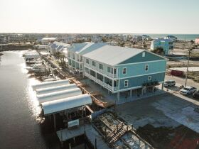 New Construction | Canal Front Townhouse w/ Slip featured photo 5