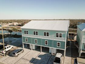 New Construction | Canal Front Townhouse w/ Slip featured photo 3