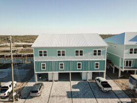 New Construction | Canal Front Townhouse w/ Slip featured photo 6