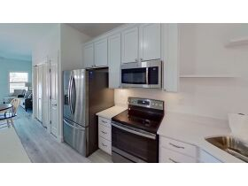 New Construction | Canal Front Townhouse w/ Slip featured photo 7