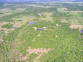 SECLUDED WOODED  ACREAGES AUCTION-STILLWATER OK AREA featured photo 1