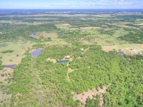 SECLUDED WOODED  ACREAGES AUCTION-STILLWATER OK AREA featured photo 4