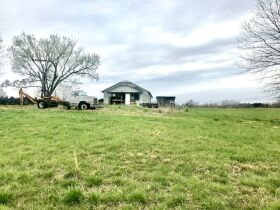 175 Acres offered in 2 tracts  with lake, 3 ponds, home place, county water available, 2 wells,  barns, outbuildings, fence. featured photo 7