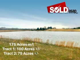 175 Acres offered in 2 tracts  with lake, 3 ponds, home place, county water available, 2 wells,  barns, outbuildings, fence. featured photo 1