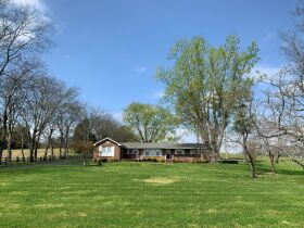 45+/- Acres Offered in Tracts - 4 BR, 3 BA One Level Home - Barns, Outbuildings, Pond, Creek - Auction July 17th featured photo 6
