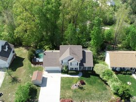 AUCTION featuring 3 BR, 2.5 BA Home with Bonus Room, Office, Basement and Additional Unimproved Lot Selling As a Whole featured photo 6