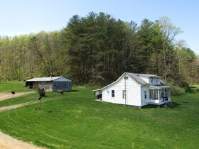 200 Acre Country Retreat W/ Shop & Two Houses Sold in Parcels featured photo 1