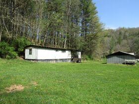200 Acre Country Retreat W/ Shop & Two Houses Sold in Parcels featured photo 2