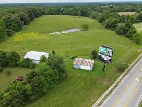 25 +/- Acres/Commercial Property, House, 2 Barns & Personal Property - Nola Brockman Estate at Absolute Auction featured photo 1