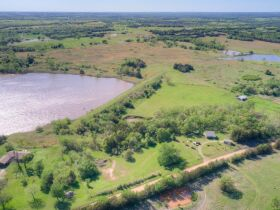 STILLWATER/PERKINS OKLAHOMA AREA HOME AND LAND AUCTION-100 Acres w/ 9 +/- acre lake and like new custom built home-PLUS John Deere Tractors and Acreage Equipment featured photo 2